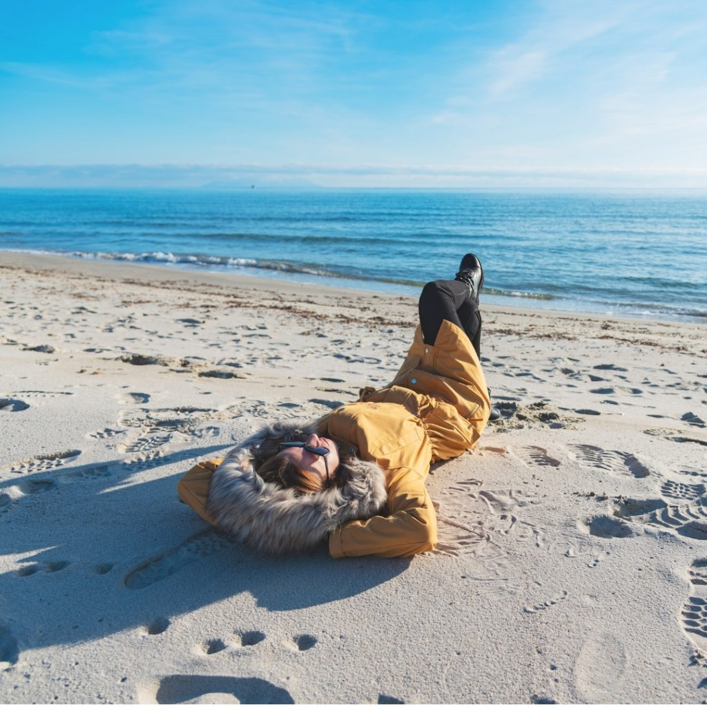 Laying on Beach with Coat on