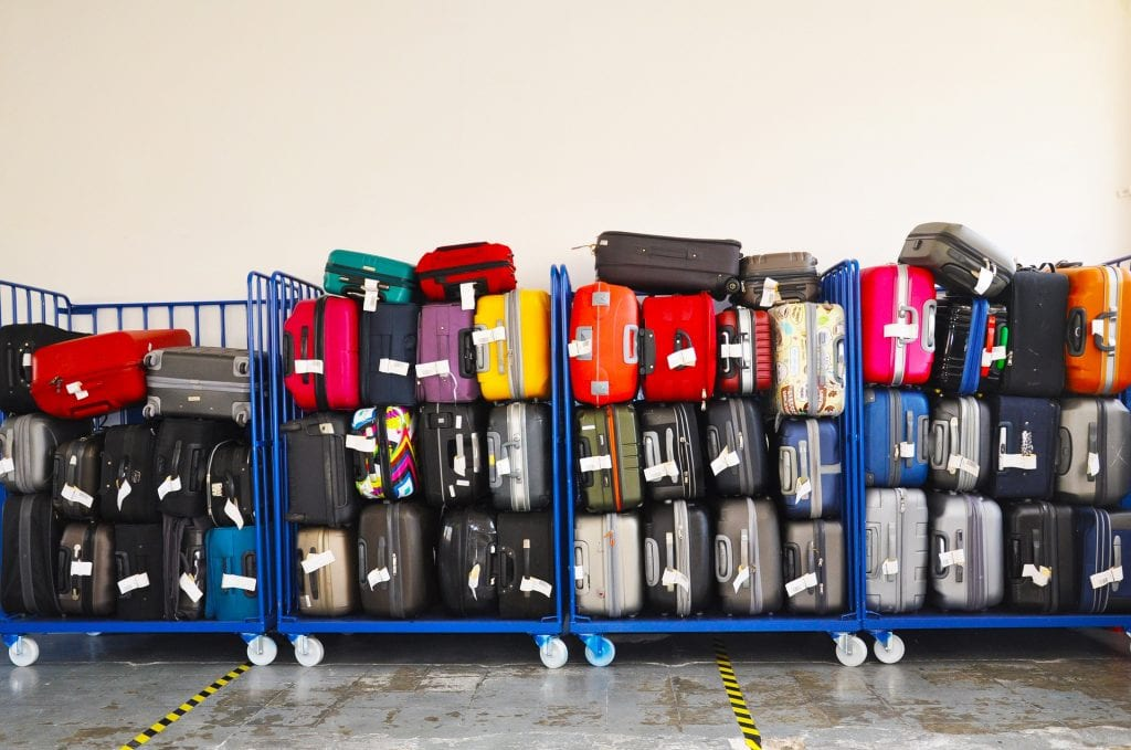 Packed Suitcases on luggage rack